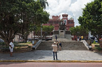 tourists take pictures in front of the simon bolivar monument in casco viejo panama city