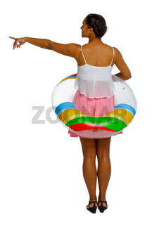 Back view of an afro american woman with an inflatable circle which points hand up.