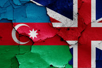 flags of Azerbaijan and UK painted on cracked wall