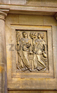 Ancient bas-reliefs on the Windows and walls of historical buildings