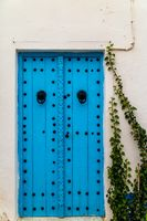 Decorated door of a traditional house in Tunisia