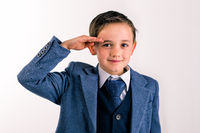 Young boy dressed up saluting