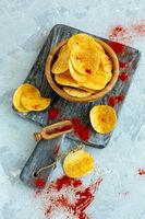 Potato chips with sea salt and paprika.