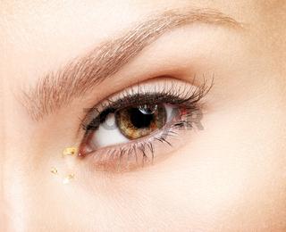 Female eye. Closeup macro beauty portrait of young woman face