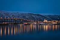 Tromso Bridge across Tromsoysundet strait at night