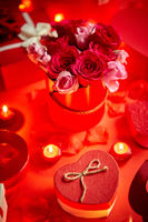 Valentines day romantic decoration with roses, boxed gifts, candles