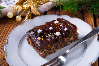 Christmas poppy seed cake with chocolate, nuts and raisins