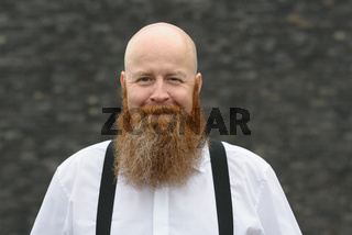 Balding bearded man with a friendly smile
