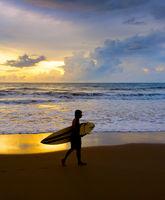 Surfer beach silhouette surfboard. Bali