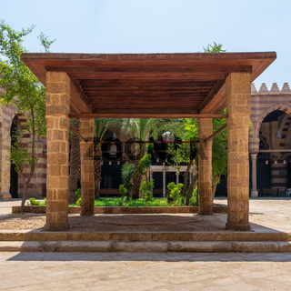Pergola with four columns and wooden ceiling at courtyard of public mosque in Cairo, Egypt