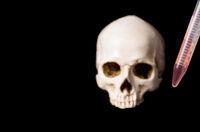 blood sample and skull on black background