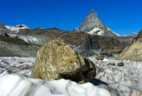 Big rocks moving downwards on the Gorner Glacier, Matterhorn behind, Zermatt, Valais, Switzerland