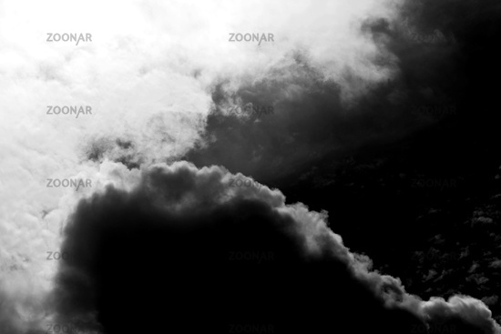 Dark storm clouds with sunbursts
