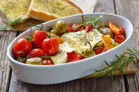 Baked feta cheese with olives and tomatoes