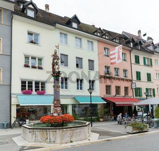 view of the historic 'Fountaine de Saint-Maurice' or Saint-Maurice fountain in the Swiss city of Delemont