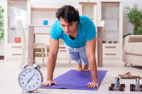 Young handsome man doing morning exercises