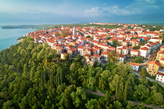 Town of Omisalj on Krk island green hill aerial view
