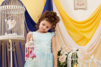 Adorable little girl posing in decorated studio