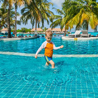 Toddler boy in resort swimming pool