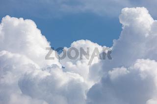 Fluffy cloud edge and blue sky