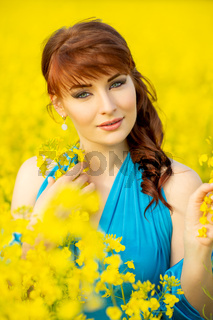 beautiful girl in blue dress with yellow flowers