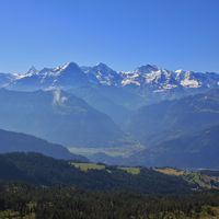 Famous mountains Eiger, Monch and Jungfrau just after sunrise. View from Mount Niederhorn. Beatenber