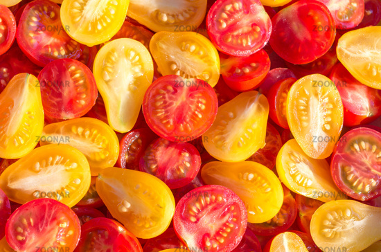 Fresh halves of Brazilian cherry tomatoes. Background of many colorful cherry tomatoes. Cherry tomat