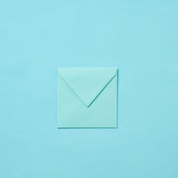 Blank craft envelope, mock-up on a pastel background.