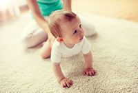mother with baby on floor at home