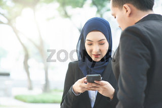 Business women using mobile phone