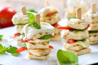 Baked appetizers with tomato and mozzarella