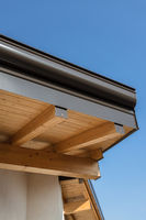 Rain gutter on the roof ecological house