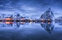Beautiful fishing village with boats at night, Lofoten islands