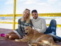 Couple with dog enjoying time on beach