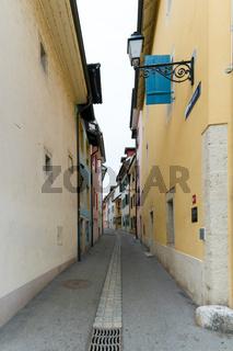 narrow empty street in the historic old town of Delemont in northwestern Switzerland
