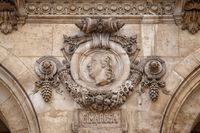 Paris, France, March 31, 2017: Architectural details of Opera National de Paris: Cimarosa Facade sculpture. Grand Opera is famous neo-baroque building in Paris, France - UNESCO World Heritage Site