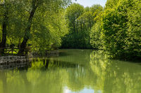 Calm peaceful river in the park near Postojna cave system in Slovenia