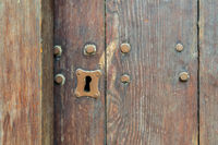 Keyhole in old wooden grunge door