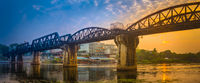 The bridge on the river Kwai at sunrise. Railway in Kanchanaburi, Thailand. Panorama