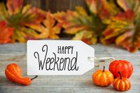 Label With Text Happy Weekend, Pumpkin And Leaves