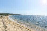 Wild sandy beach, Figari, Corsica, France (lens flare effect)
