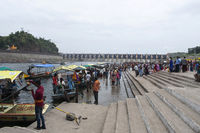 OMKARESHWAR, MADHYA PRADESH, INDIA, August 2018, Tourist and devotees wait to take boats at Ghats at Omkareshwar Temple.