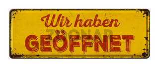 Vintage rusty metal sign -  German Translation of We are open - Wir haben geoeffnet
