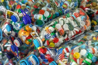 Compressed plastic bottles in stacks at the recycle factory