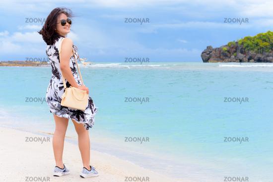 Cute teen girl tourist on the beach in Thailand