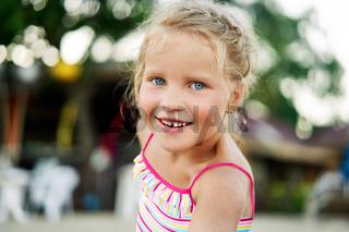 Close up portrait of happy cute little blonde girl