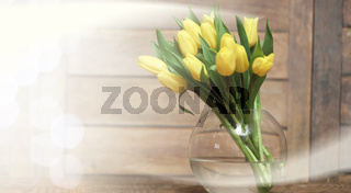 bouquet of yellow tulips in a vase on the floor