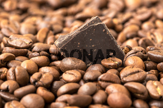 Coffee beans and piece of chocolate