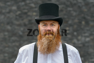 Attractive redhead bearded man in vintage fashion