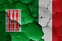 flags of Umbria and Italy painted on cracked wall